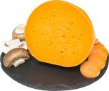 Сыр Flaman Mimolette с морковным соком 48%  0.4-0.7кг
